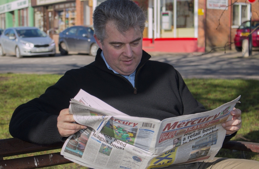 Brandon Lewis reading the Great Yarmouth Mercury