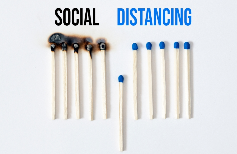 Scoial distancing concept with burnt matches