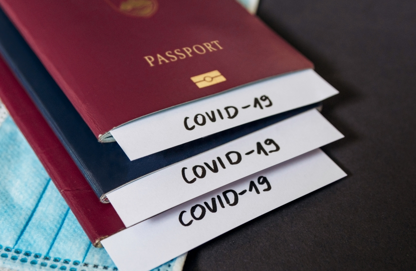 Stack of passports with covid-19 notes