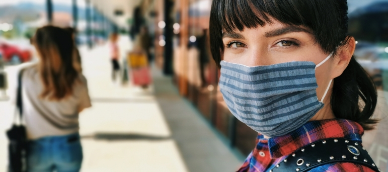 Young woman wearing face covering